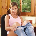 EuroBabez.com (Pics) - Megan - Brunette Megan slides down her panties to poke her pussy